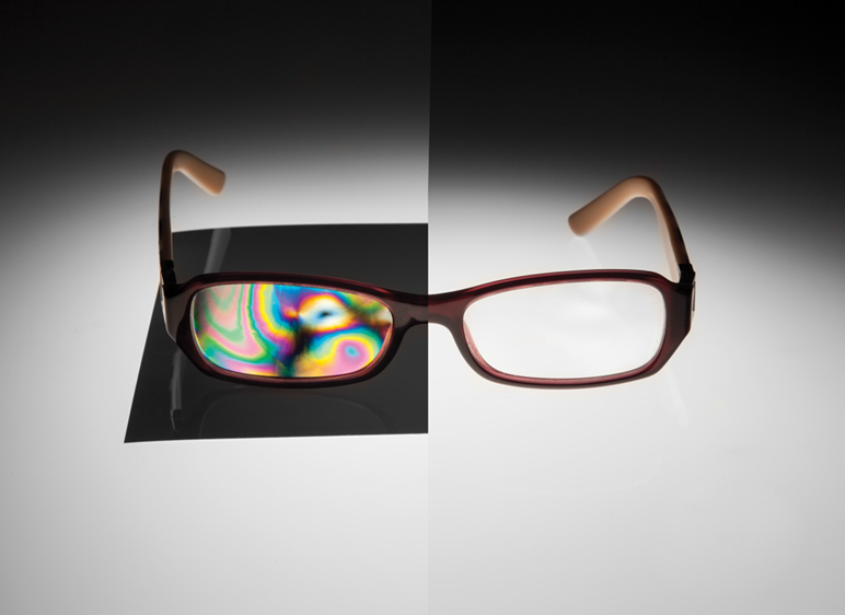 Figure 12: A pair of glasses appears clear without polarization; however, the use of polarizers makes visible the material stress variations and they appear as color variations.</h5>